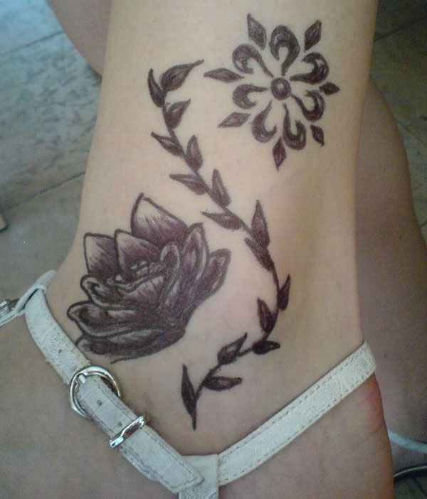 Tattoo with lotus on ankle