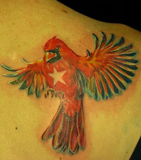 Blue and red parrot tattoo