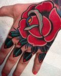Hand tattoo with red rose