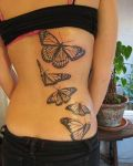 Black butterflies tattoo