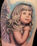 Pretty girl as angel tattoo