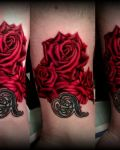 Tattoo with red roseand sign