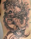Two skulls and dragon tattoo