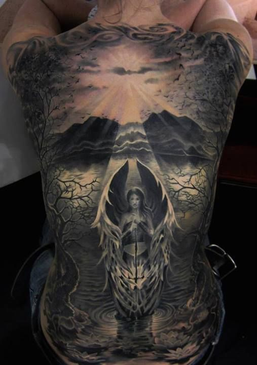 Angel and scenery tattoo