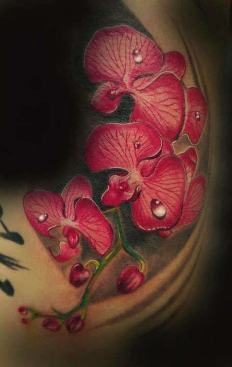 Back tattoo with big orchids