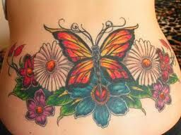 Buttefly and flowers tattoo