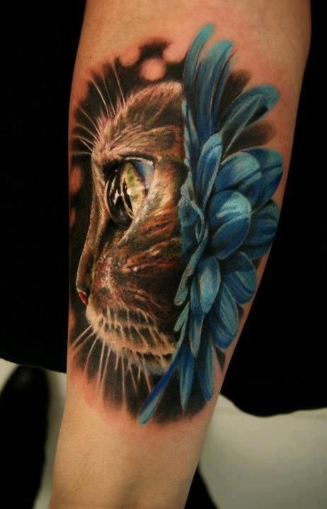 Cat with blue daisy tattoo for Cat eyes tattoo designs