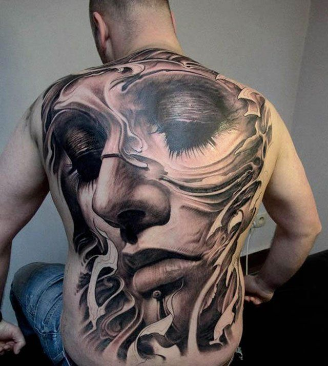 Face tattoo on back
