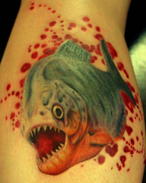 Fish with teeth tattoo