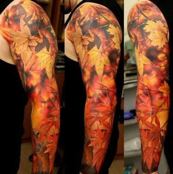 Gold leafs as arm tattoo