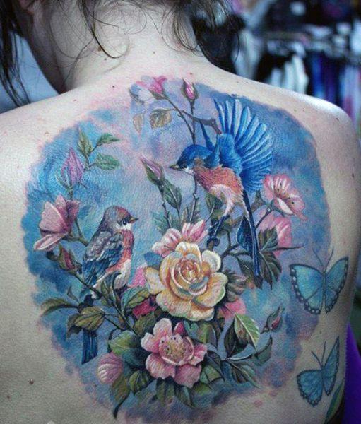 Flowers birds butterflies tattoo
