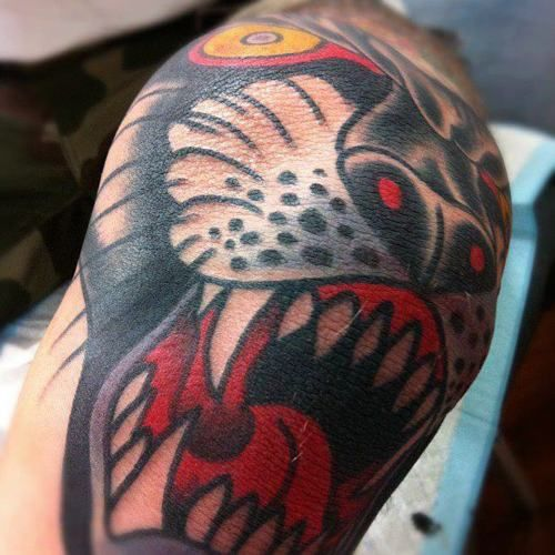19 Knee Tattoo Designs Images And Pictures: Panther With White Teeth