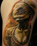 Arm tattoo with alien