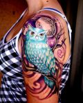 Arm tattoo with blue owl