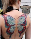 Back tattoo with butterfly