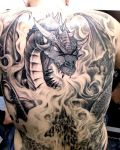Back tattoo with dragon