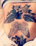 Belly tattoo with butterfly and wings