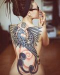 Big bird tattoo on back