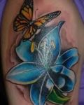 Butterfly and blue lily tattoo