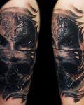 Dark face and skull tattoo