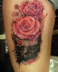 Dark skull with roses tattoo