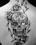 Decorative skull and rose tattoo