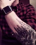 Elbow tattoo with trees