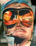 Face with glasses tattoo