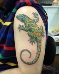 Green and yellow lizard tattoo