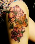 Hip tattoo with lilies