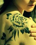 Girl with rose tattoo