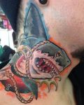 Neck tattoo with shark