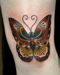 Butterfly tattoo on knee