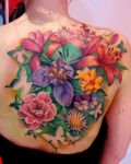 Colourfull flowers tattoo back