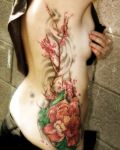 Peony and cherry blossom tattoo