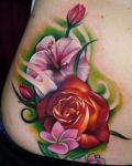 Pink and red flowers tattoo