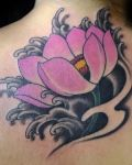 Pink lotus on black water tattoo