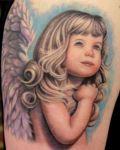 Pretty girl as angel tattoo
