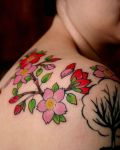 Red and pink cherry blossom tattoo
