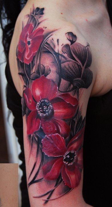 Tattoo with three red flowers