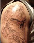 Arm tattoo with skull