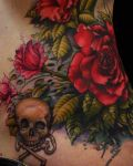 Roses and skull hip tattoo