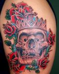 Skull with red flowers tattoo