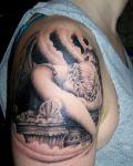Sleeping angel tattoo