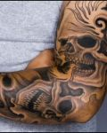 Sleeve tattoo with skulls