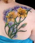 Tattoo with two yellow daffodils