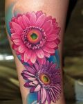 Two pink flowers tattoo