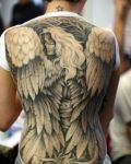 Woman angel tattoo