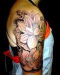 Two lotus tattoo